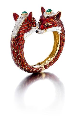 A diamond, emerald, ruby and enamel double fox head bangle bracelet, David Webb