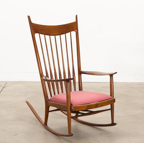 Sam Maloof (1916-2009) Rocking Chaircirca 1968walnut, upholsterybranded 'MALOOF designed made' and inscribed 'RUDOLPH 50.70'height 45in (114.5cm); width 28in (71.5cm); depth 42in (107cm)