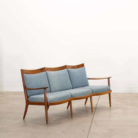 Sam Maloof (1916-2009) Three Seat Settlecirca 1968walnutbranded 'designed made MALOOF california'height 33 1/2in (86cm); width 75 1/2in (192cm) depth 25in (64cm)