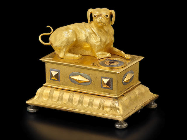 A very rare gilt quarter striking alarm clock with automaton of a hound South German, early 17th century
