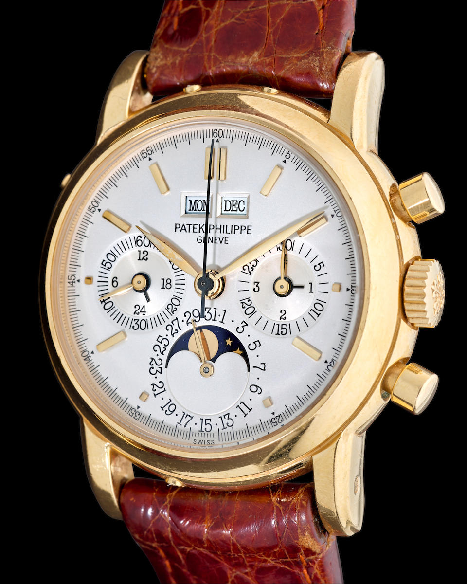Patek Philippe. A fine 18K gold chronograph wristwatch with perpetual calendar and moon phaseRef: 3970 E, second series, 1990