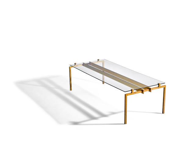 Marc du Plantier (1901-1975) Coffee Table1955gilt bronze, glassheight 16in (41cm); width 57in (145cm); depth 23 1/2in (60cm)