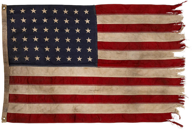 THE BATTLE FOR GUADALCANAL: A 48 STAR ENSIGN FLOWN FROM TORPEDO BOAT PT-37. An American ensign flown from PT-37. 550 x 900 mm. the flag  with 48 stars on blue ground at upper left canton, on a red and white horizontal striped field,