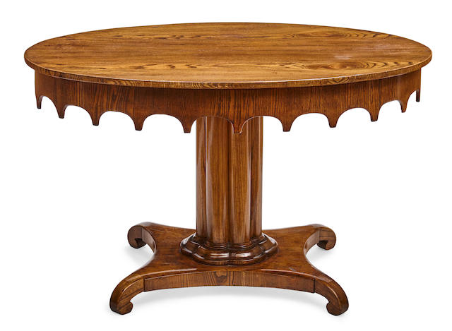 A Baltic Neoclassical elm oval center table early 19th century