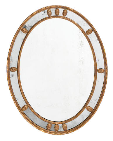 A George III style giltwood oval mirror 19th century