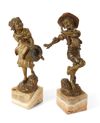 A pair of Austrian cold painted bronze figures of children at playCarl Kauba (Austrian, 1865-1922)early 20th century