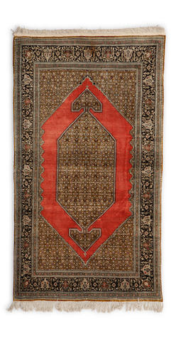 A Qum silk rug Central Persia dimensions approximately 7ft x 4ft 5in (213 x 134.5cm)