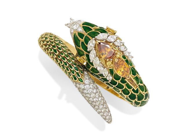 A fancy colored diamond, colored diamond, diamond, enamel, 18k gold and platinum hinged bangle