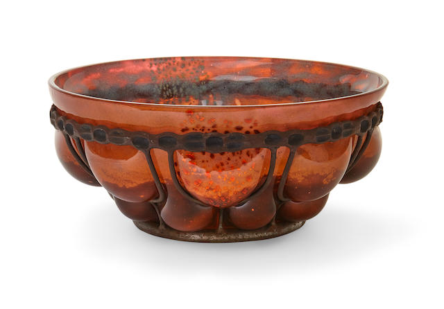 A Louis Majorelle wrought iron and Daum Frères mottled glass Bowlcirca 1925 with foil inclusions, signed L. Majorelle and DAUM NANCY FRANCE with the cross of Lorraineheight 5in (12.8cm); diameter 11in (28cm)