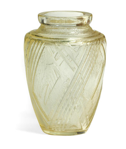 A Daum Frères acid cut yellow glass vasecirca 1925 Signed DAUM NANCY FRANCE with the Cross of Lorraineheight 10 1/8in (26cm)
