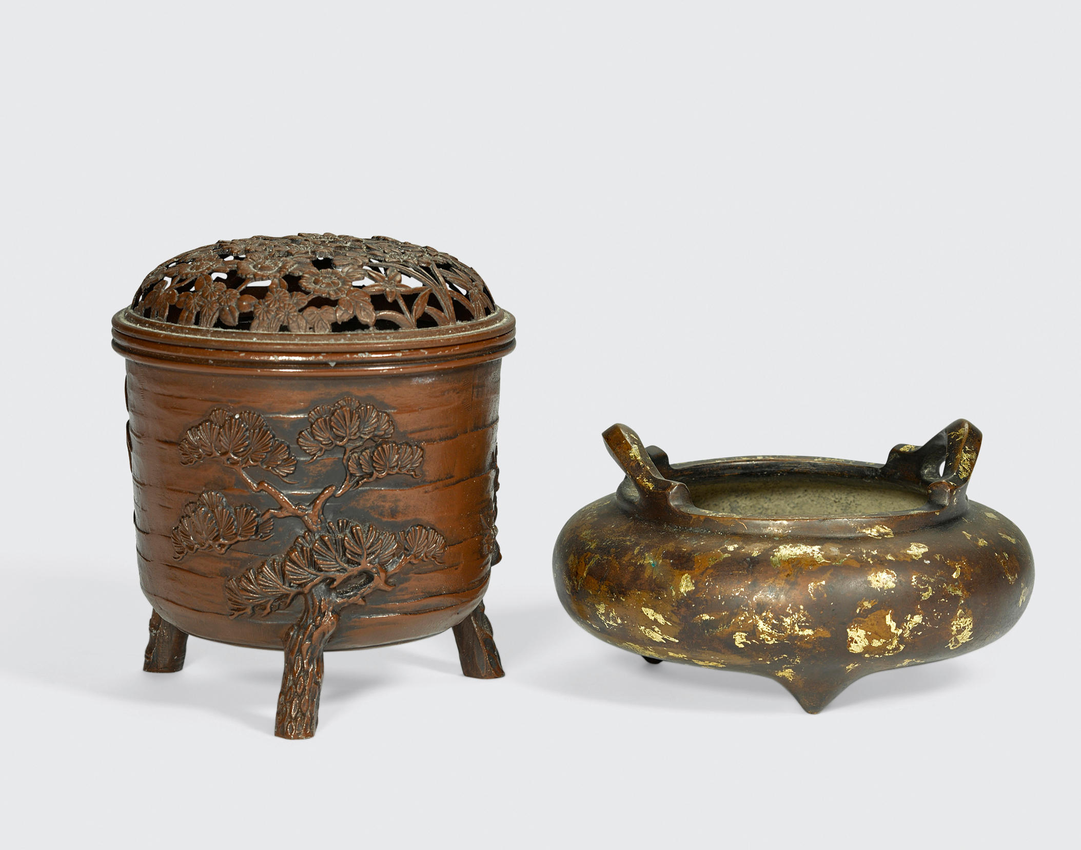 Two metal tripod censers