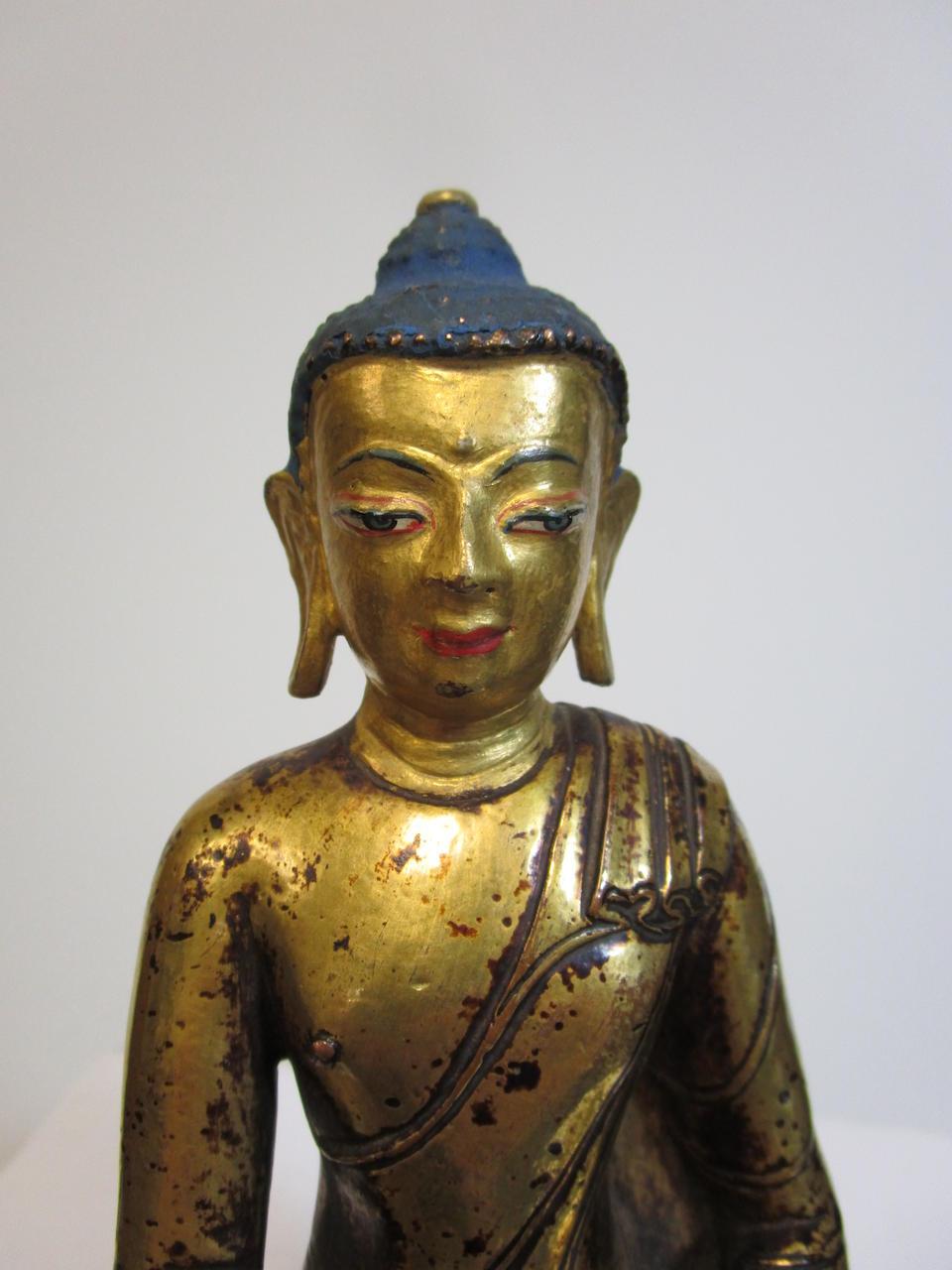 A GILT COPPER ALLOY FIGURE OF BUDDHA Tibet, 14th/15th century