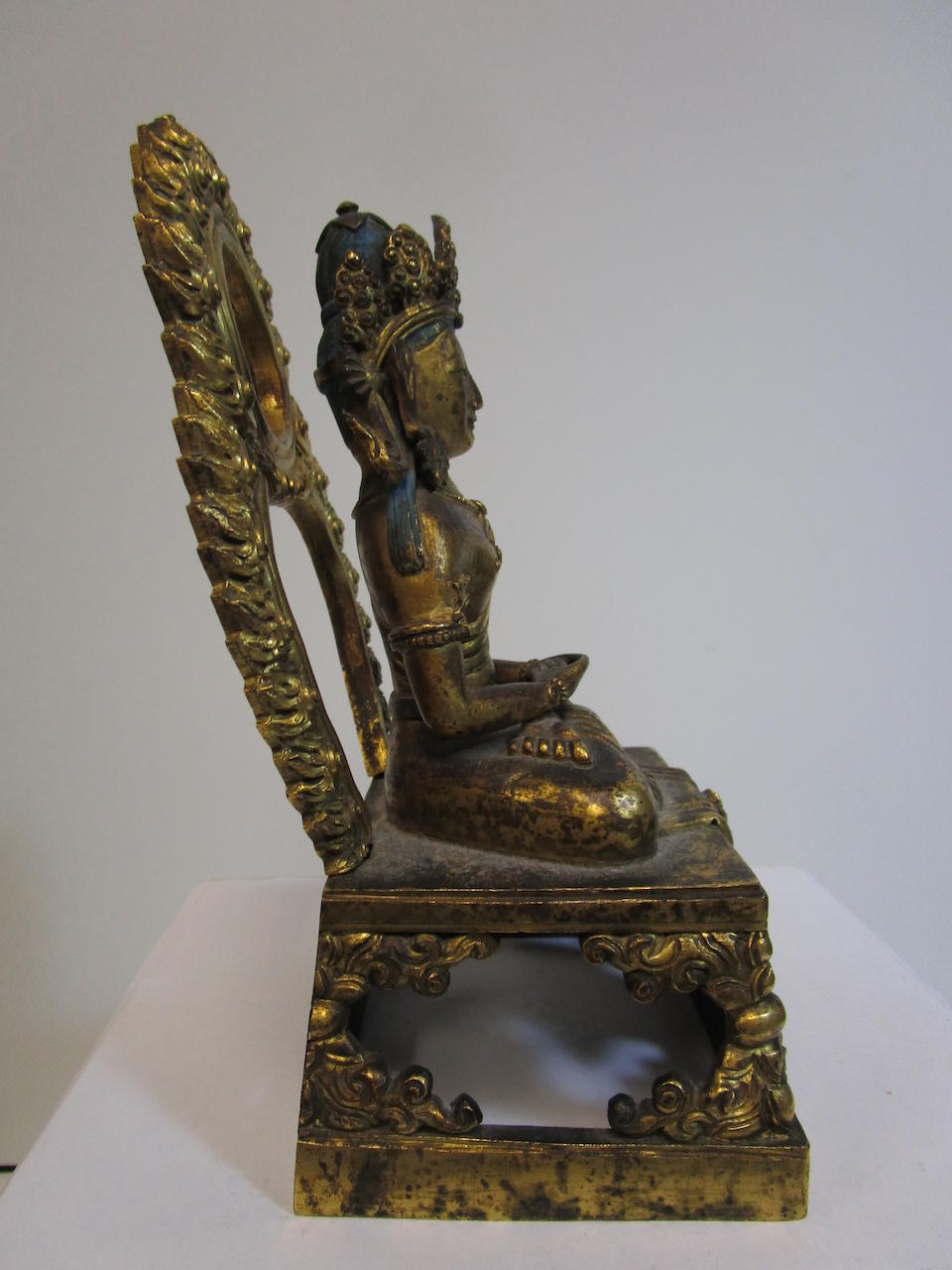 A gilt bronze seated figure of Amitayus  Qianlong period, dated by inscription to 1770
