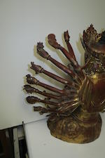 A gilt-lacquered bronze seated figure of a twenty-four arm  Guanyin Ming dynasty, 16th/17th century