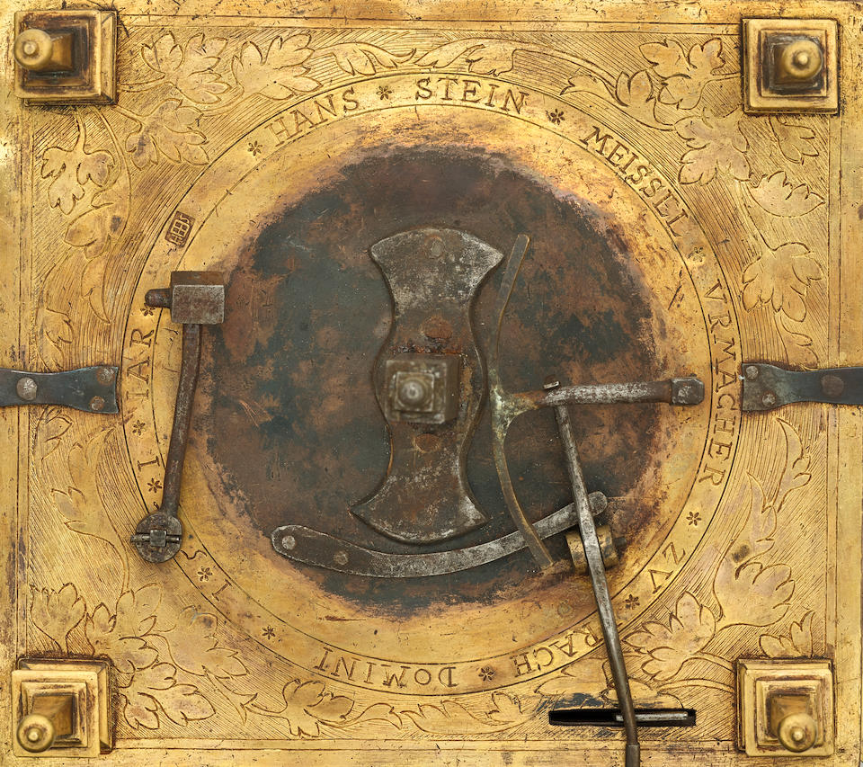 An important early gilt brass hour striking table clock with 24-hour dial, day / night indication, and alarm, the side panels with finely engraved images of the saints Christopher, Paul and Simon the Zealot, after Albrecht Durer Hans Steinmeissel, Prague, dated 1551