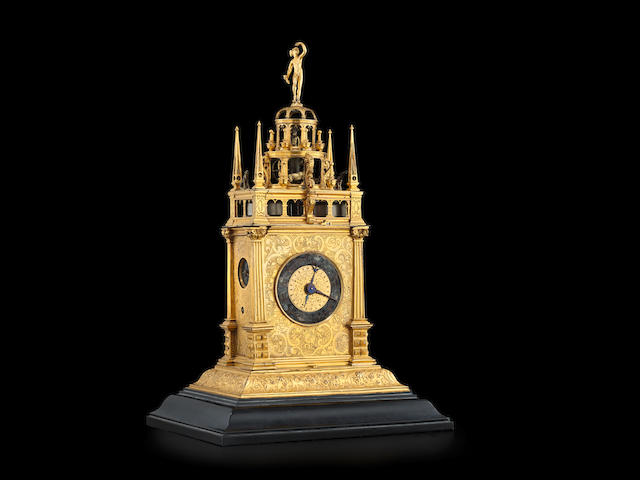 A gilt brass quarter striking automata table clock with alarm   probably Augsburg, circa 1630