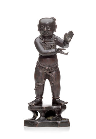 A BRONZE FIGURE OF AN ATTENDANT DEITY Ming dynasty
