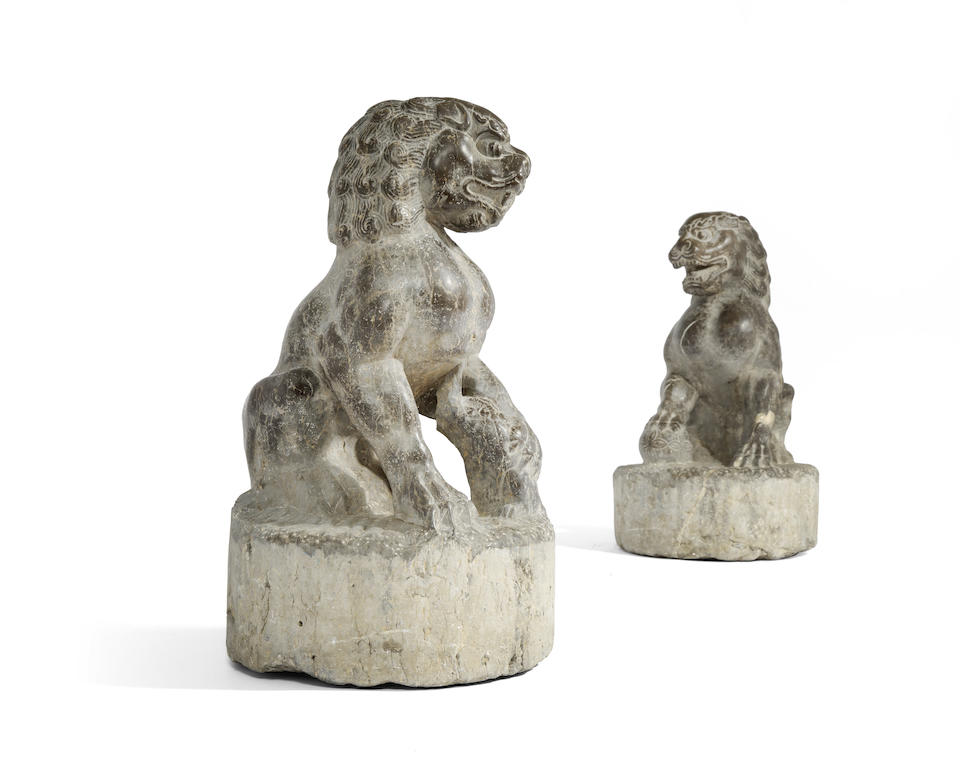 A PAIR OF LIMESTONE GUARDIAN LIONS Ming dynasty or earlier