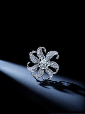 An Art Moderne diamond clip, Paul Flato, with accompanying fitted bangle, Van Cleef & Arpels,