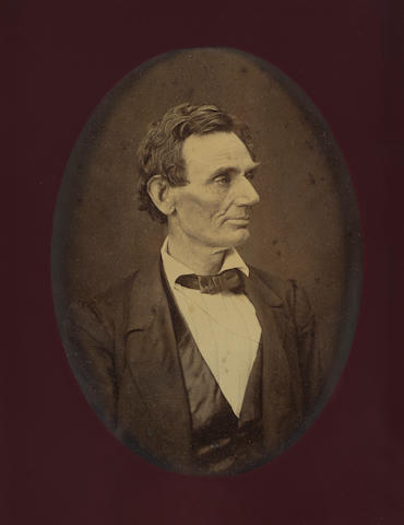 LINCOLN, ABRAHAM. 1809-1865. HESLER, ALEXANDER. Albumen print photograph mounted on board, 8 1/4 x 6 1/2 inches, printed by George B. Ayers c.1881,