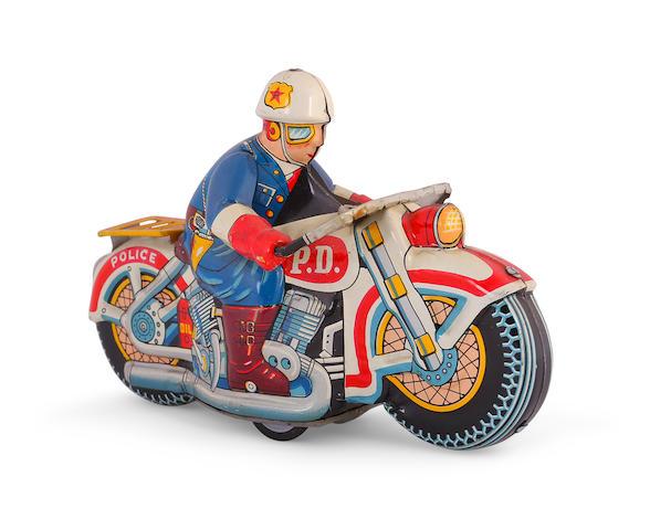 A tin lithograph Policeman toy,