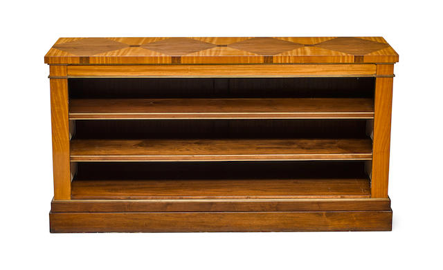 A Chester Jones brass mounted satinwood and walnut low bookcase
