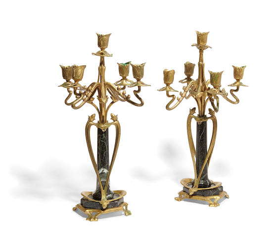 A Pair of Art Nouveau bronze and verde antico marble five light candelabra Circa 1900