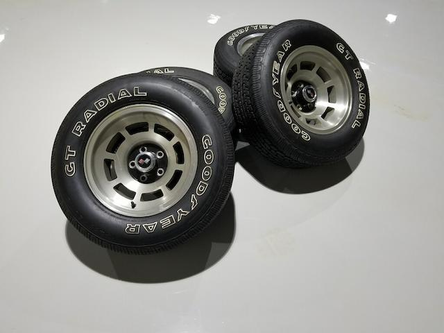 Set of four aluminum wheels with center caps for a 1979 Chevrolet Corvette.