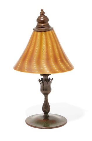 A Tiffany Studios Favrile glass  Persian shade on an associated Tiffany Studios bronze candlestick base