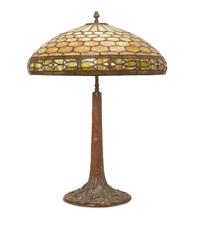 A Duffner and Kimberley leaded glass lamp shade and a patinated metal base Early 20th century