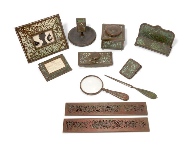 A Tiffany Studios Favrile glass and patinated bronze Ten piece desk set in the Pine  Early 20th century
