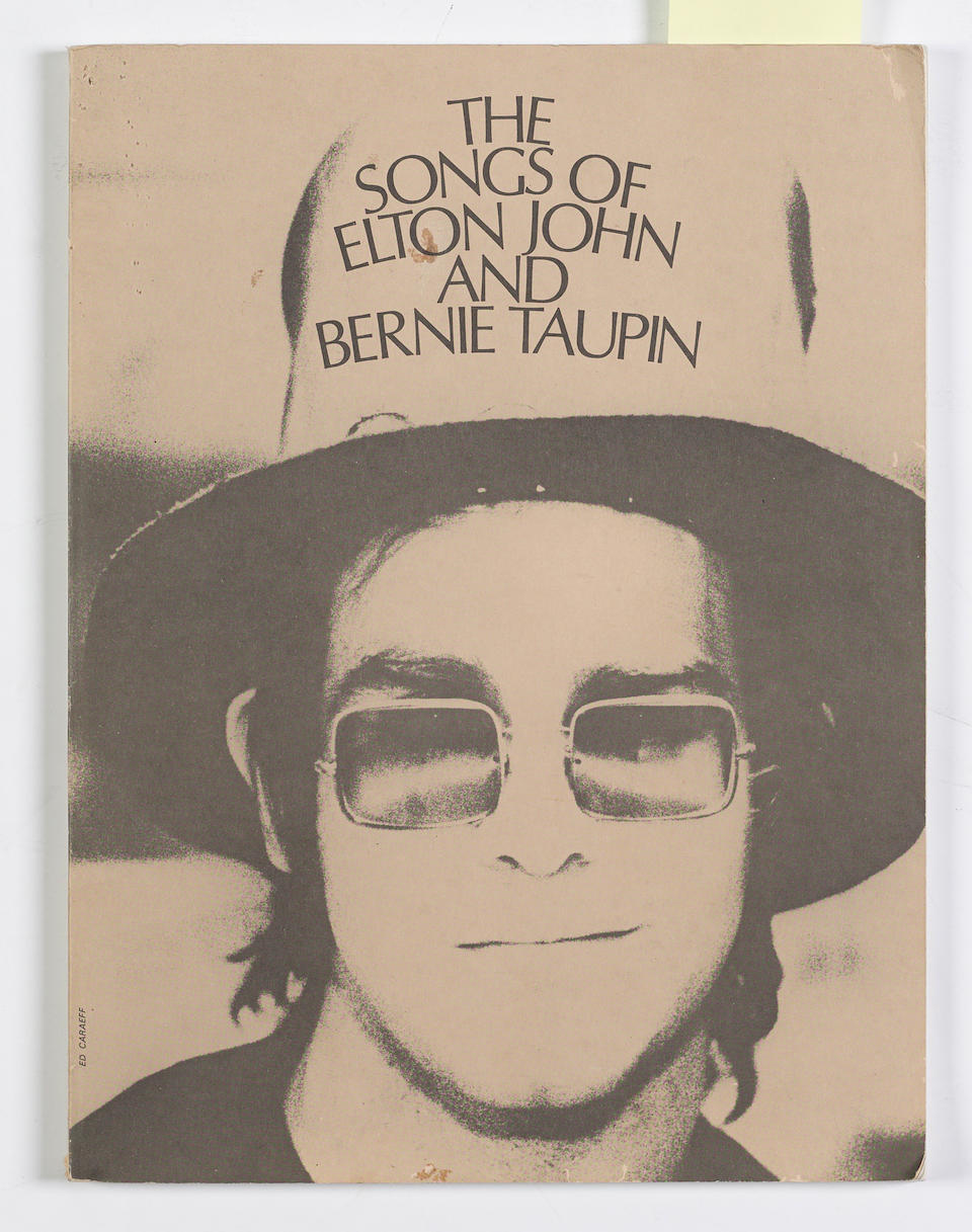 "THE ORIGINAL HANDWRITTEN LYRICS TO ELTON JOHN'S ""YOUR SONG"" with ""The Songs of Elton John and Bernie Taupin"" book of sheet music and Captain Fantastic graphic novel"