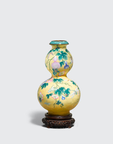 A famille rose enameled metal double gourd vase Qianlong mark, late Qing/Republic period