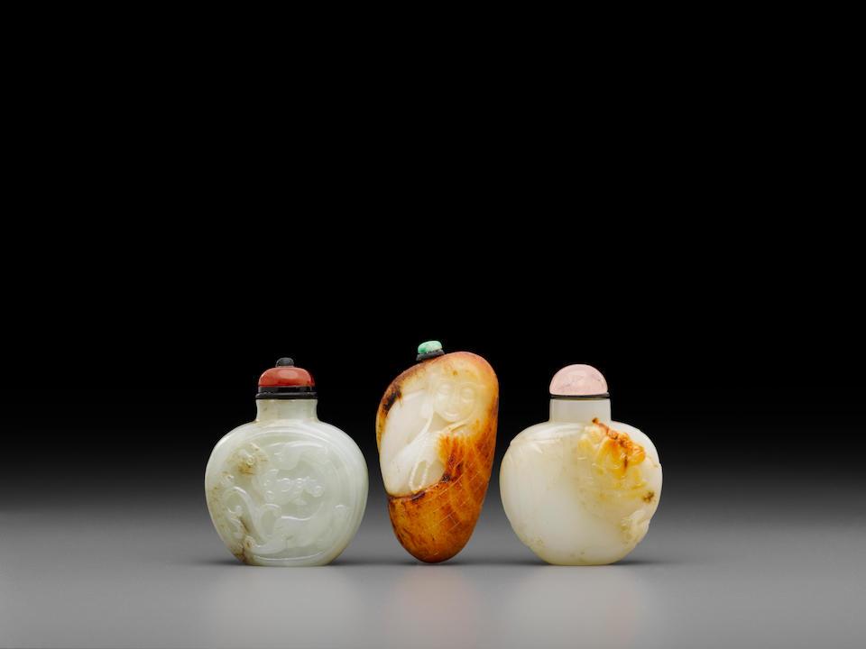 Three carved jade snuff bottles (3)