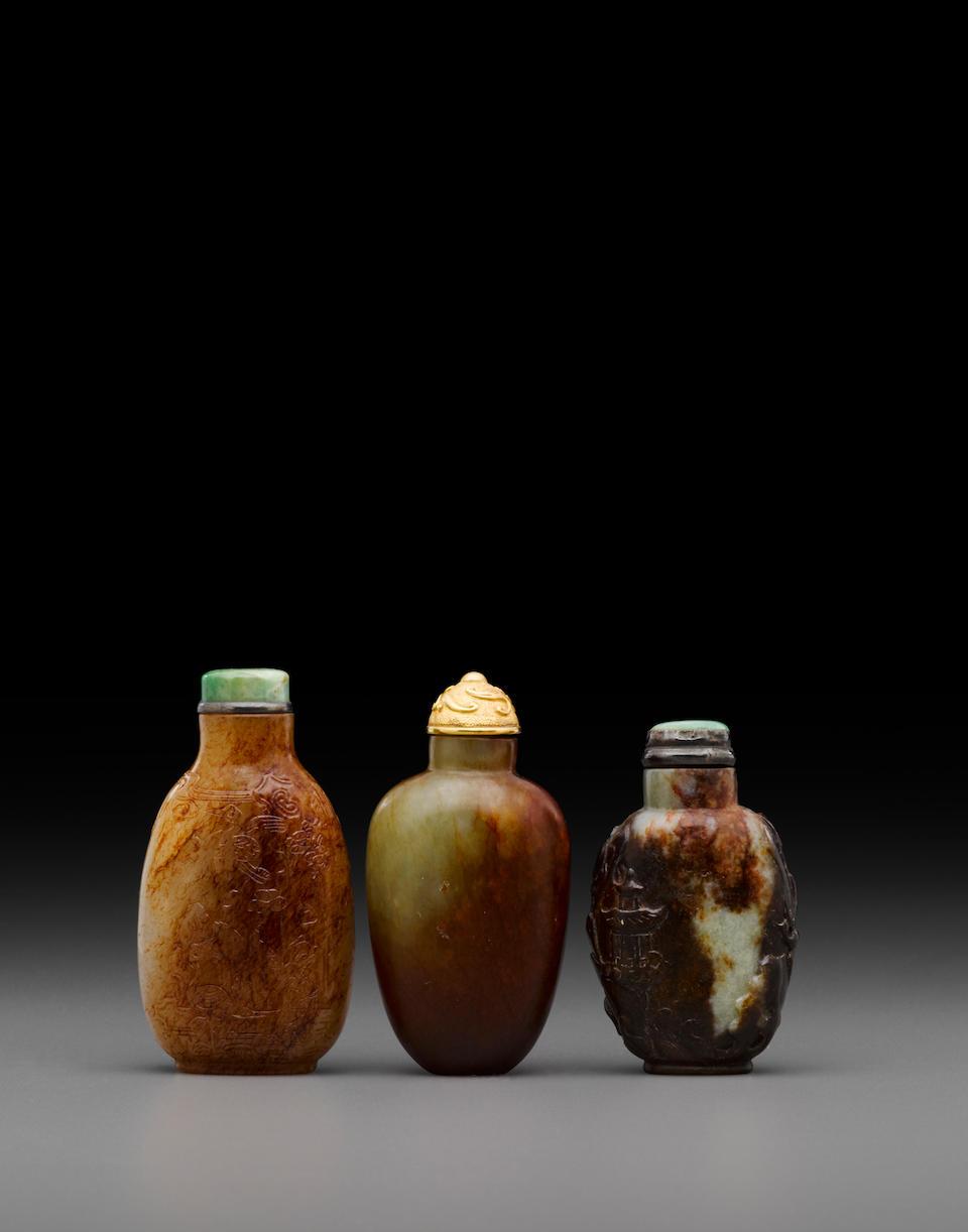 Three russet jade snuff bottles Late 19th/20th century (3)