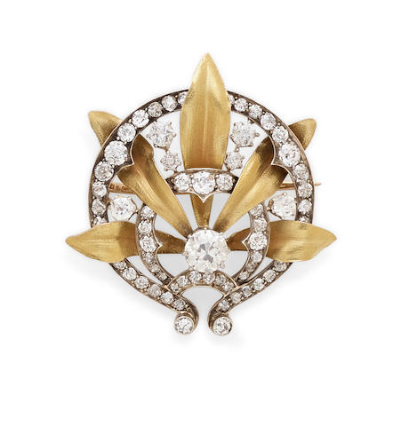 A diamond and silver-topped gold brooch