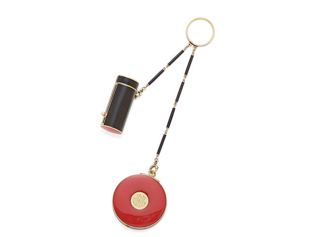 An enamel and 14K gold mirrored compact and lipstick, with adjoining black enamel ring and chain, Cartier
