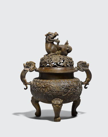 A cast bronze covered tripod incense burner with lion dog finial Xuande mark, 18th/19th century