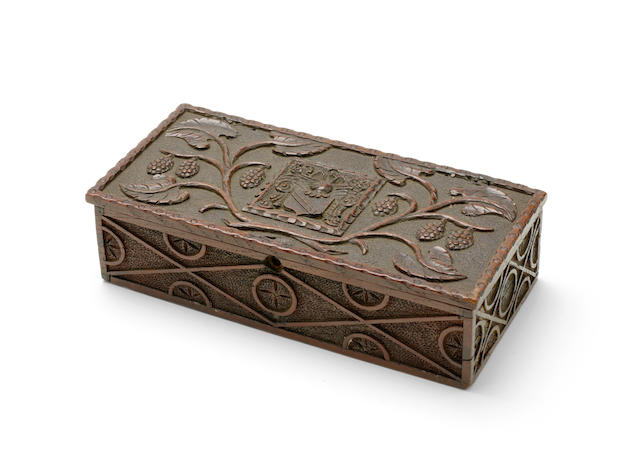 """SHAKESPEARE, WILLIAM. 1564-1616. An English mulberry-wood writing box, stamped to the underside """"SHAKESPEAR'S / WOOD / SHARP / STRATFORD ON AVON,"""" the cover carved with mulberries around Shakespeare's arms,"""