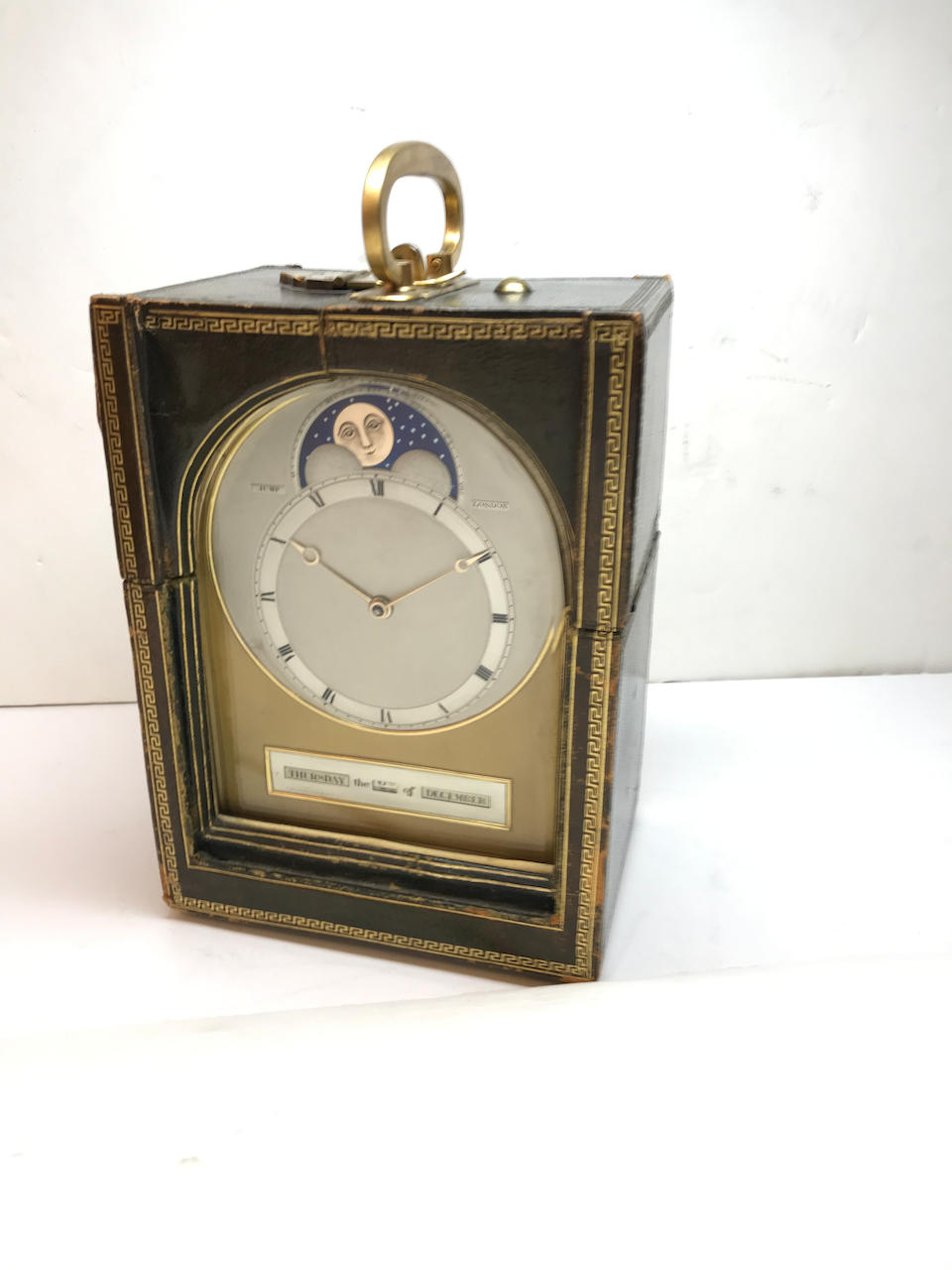 A rare silver mounted shagreen humpback traveling clock with perpetual calendar and moon phase Jump, London, circa 1900