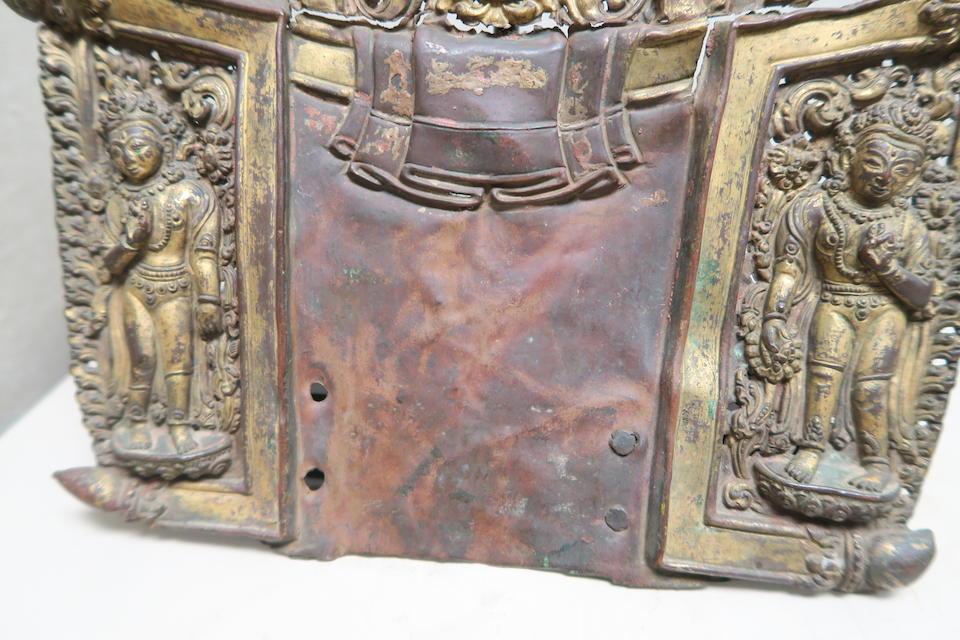 A gilt copper repoussé mandorla  Nepal, circa 14th century