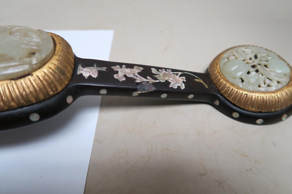 a jade and wood ruyi with mother-of-pearl inlay  19th century