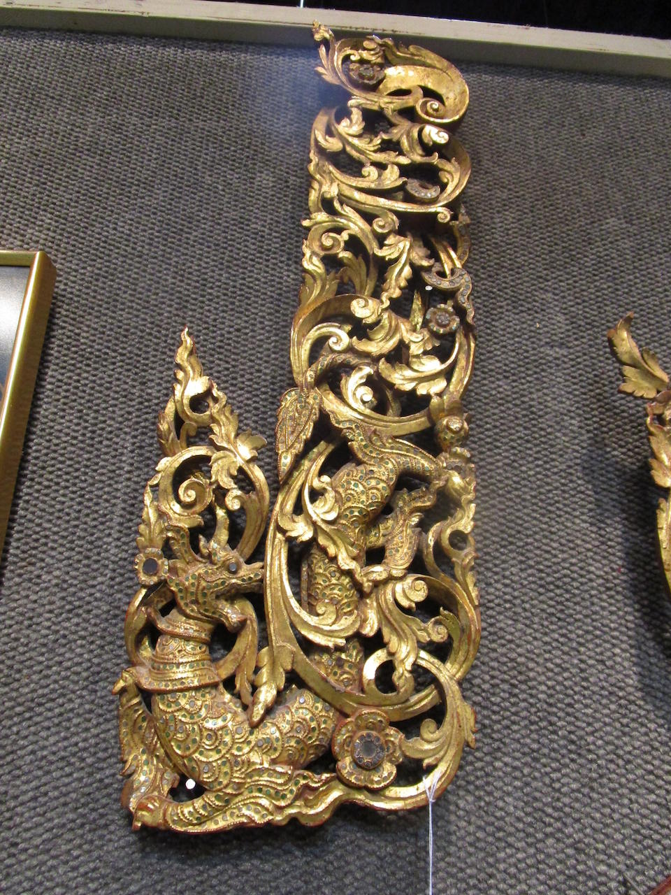 A group of three gilt lacquer and inset glass wood shrine panels Myanmar or Northern Thailand, 19th century