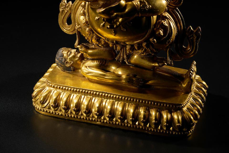 A GILT COPPER ALLOY FIGURE OF PANJARANATA MAHAKALA TIBET, CIRCA 17TH CENTURY