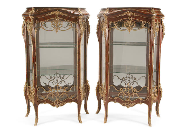 A pair of Louis XV style gilt bronze mounted tulip wood vitrine cabinets