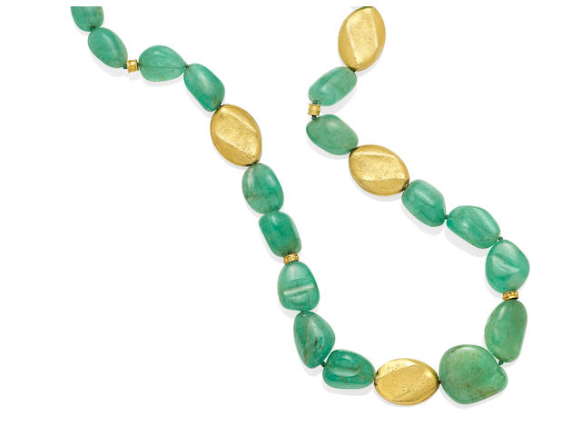 An emerald and gold bead necklace