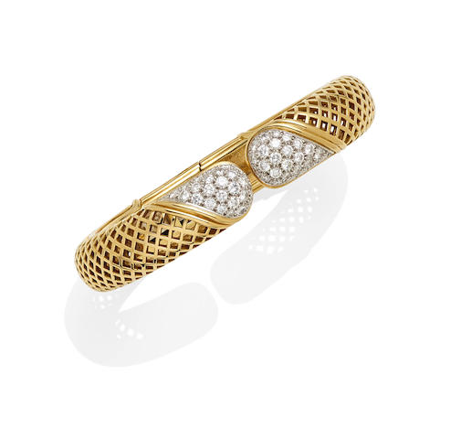 A diamond, platinum and 18k gold hinged cuff