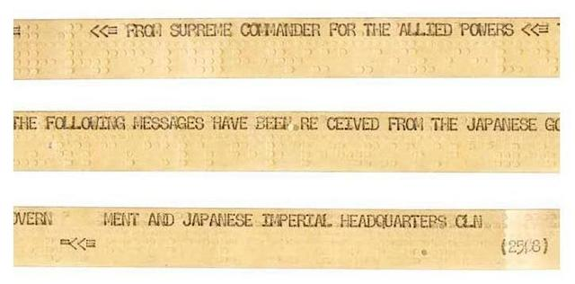 WORLD WAR II: THE JAPANESE SURRENDER NEGOTIATIONS TICKER-TAPE. American Master-spool Ticker-tape, comprising 3 separate messages regarding surrender negotiations, two from the Japanese General Headquarters and one from HQ General MacArthur. Received by Manila HQ and Relayed to Fort Shafter, Hawaii, August 16-17, 1945.
