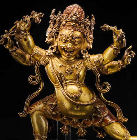 A GILT COPPER ALLOY FIGURE OF BHURKUMKUTA  CENTRAL TIBET, 15TH CENTURY