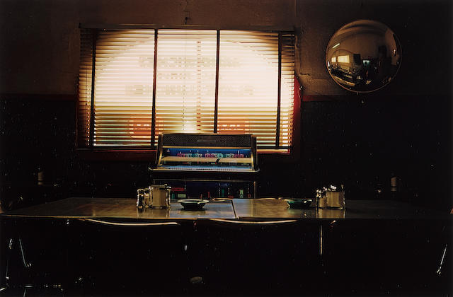 """William Eggleston (born 1939); Untitled (Table and jukebox) from """"Troubled Waters"""";"""